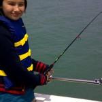Dakota fishing for perch on Grampa Chuck's Fishing Charters