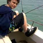 Devyn fishing for perch on Lake Erie with Grampa Chuck's Fishing Charters
